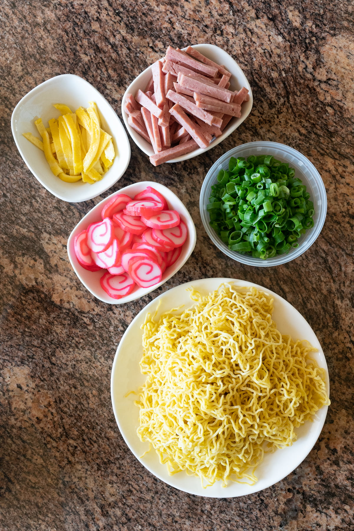 Fresh saimin noodles and little bowls with popular saimin toppings.