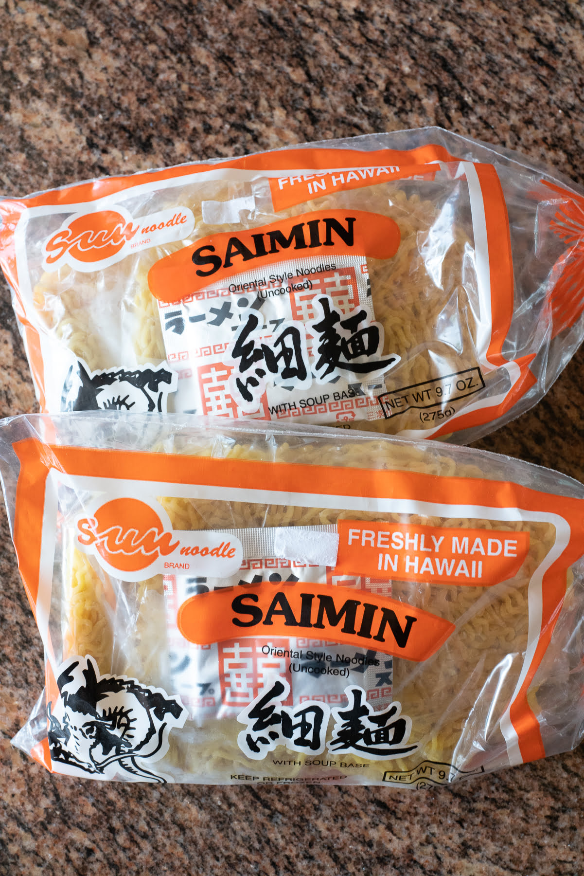 Packages of saimin noodles and seasoning powder from the supermarket.