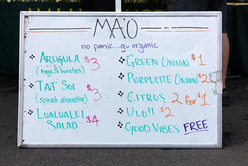Whiteboard listing the vegetables for sale at MA'O Organic Farms