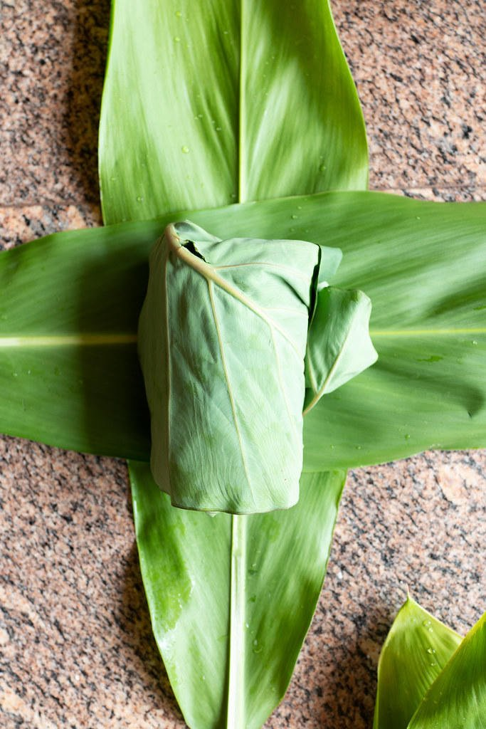 Luau leaf (from the kalo plant) in the middle. Ti leaf on the outside.