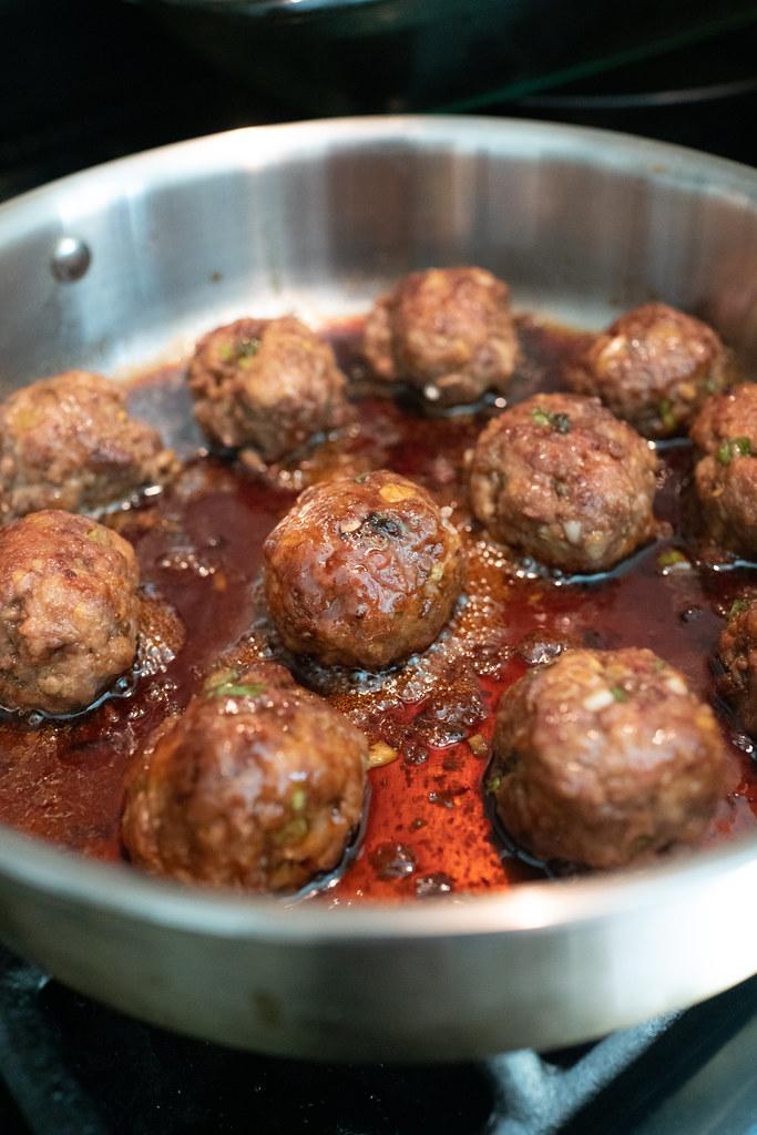 Simmering the meatballs in homemade teriyaki sauce