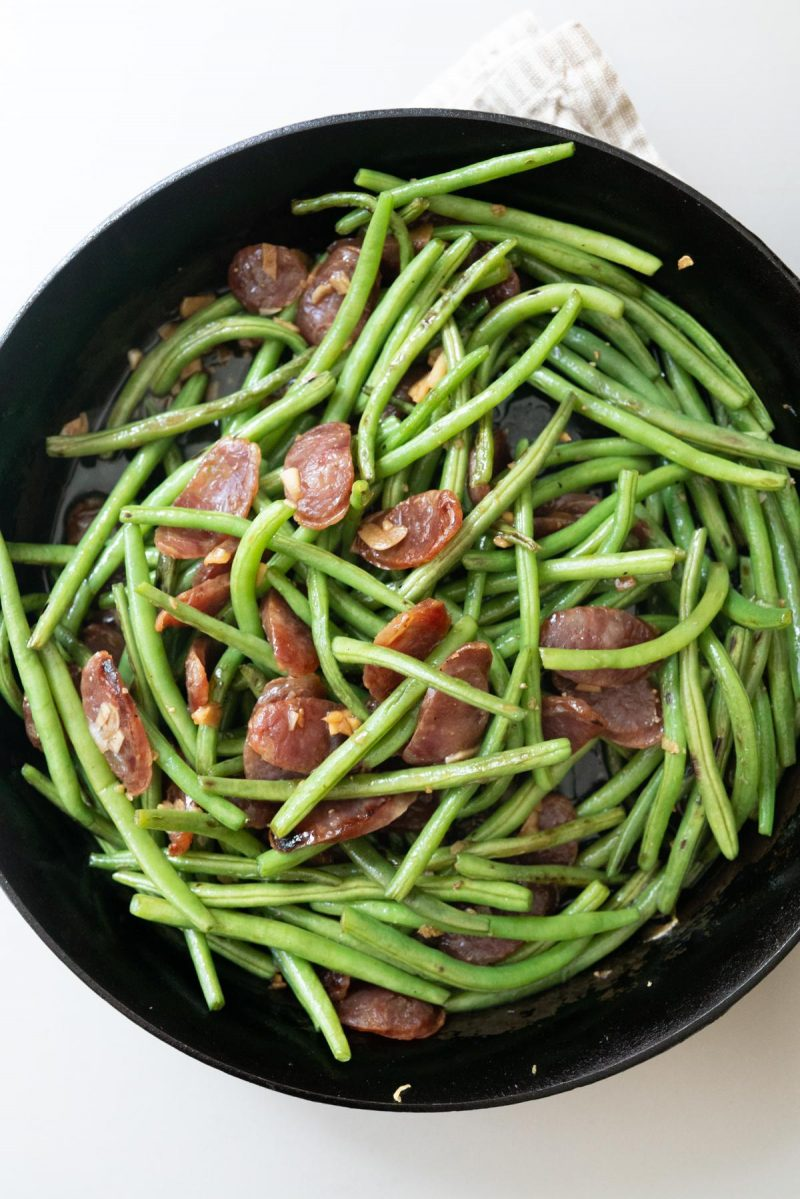 Chinese sausage and green beans in a cast iron pan, just finished cooking