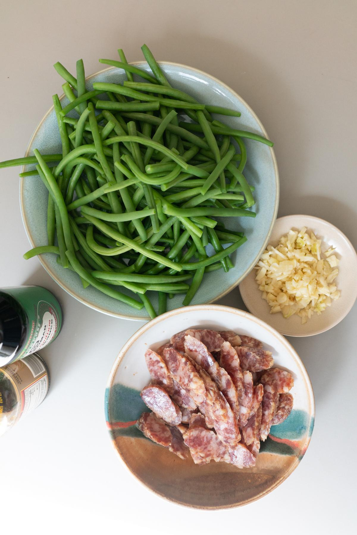 Ingredients for Chinese sausage and green beans: chinese sausage, green beans, garlic, soy sauce, and oyster sauce