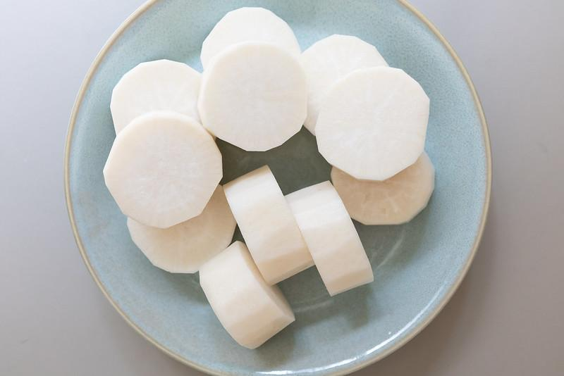 Peeled and cut daikon. Each piece is about 1-inch high.