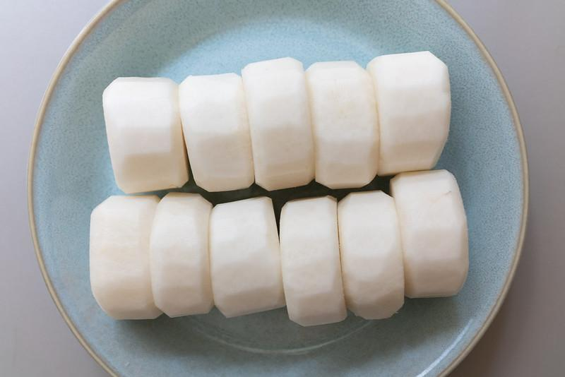 Daikon with the top and bottom edges rounded off