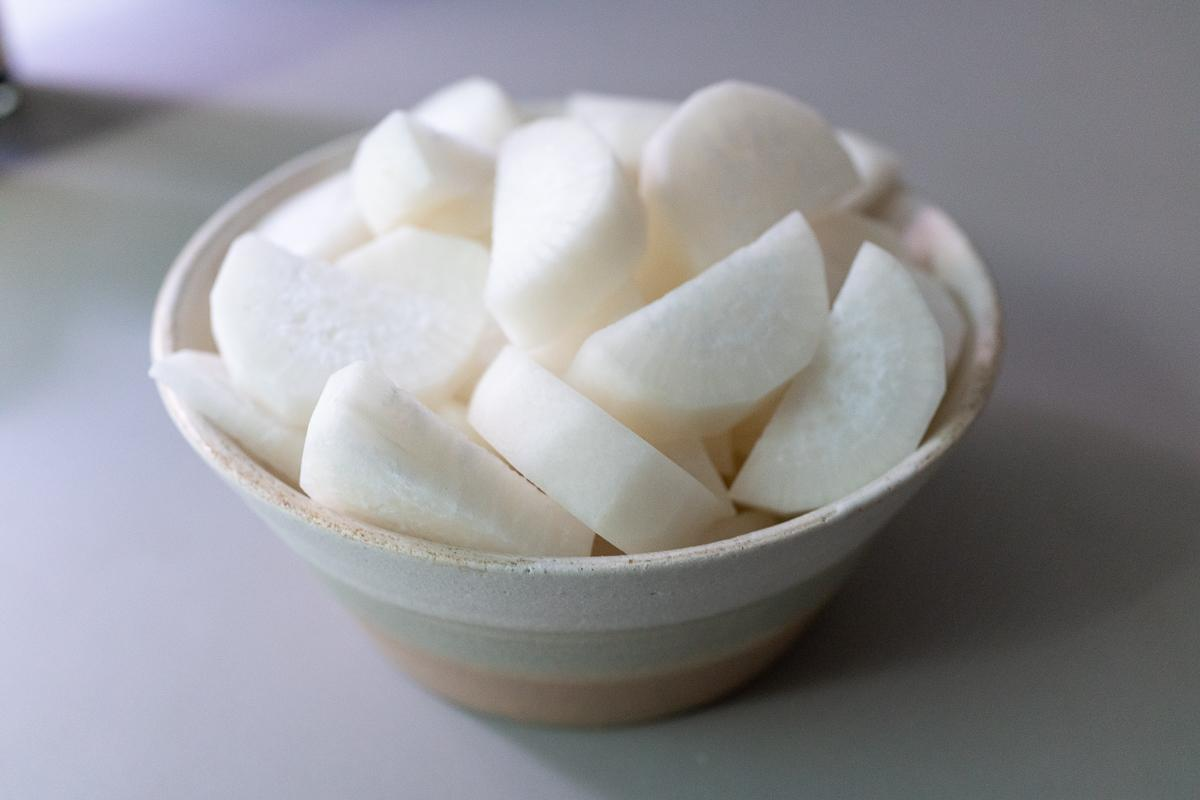 Peeled and cut daikon in a bowl