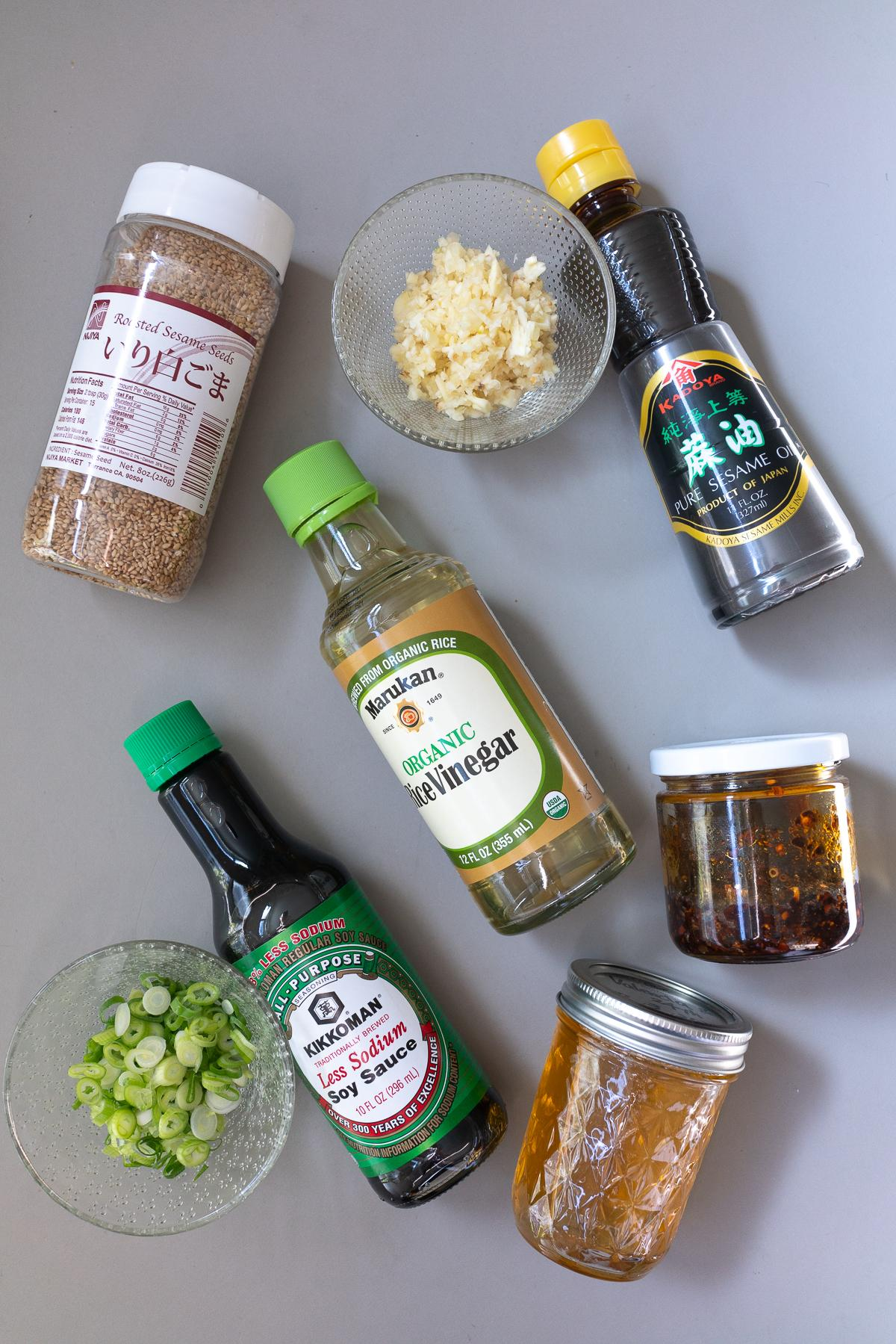 Ingredients for Dumpling Dipping Sauce (soy sauce, rice vinegar, sesame oil, chili oil, honey, sesame seeds, garlic, and green onions)