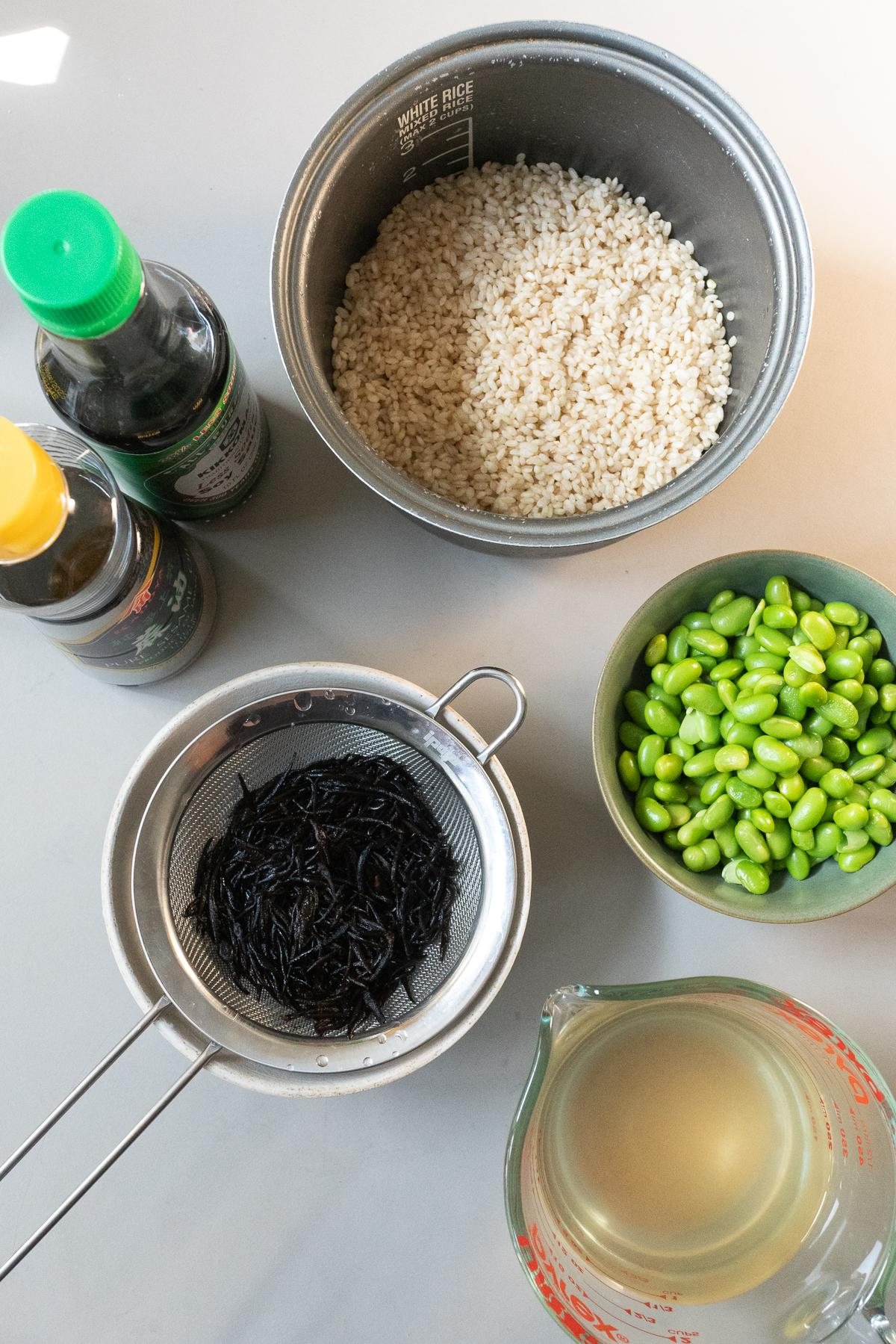 Ingredients for Edamame and Hijiki Rice (rice, hijiki, edamame, dashi, soy sauce, and sesame oil)