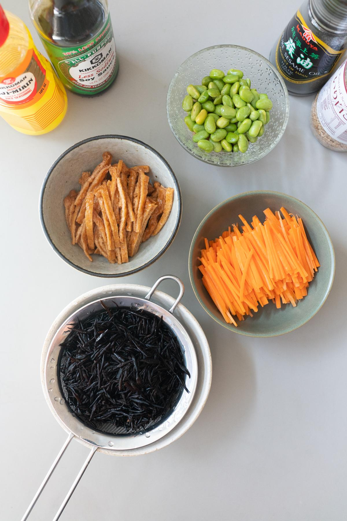 Ingredients for Hijiki Salad (dried hijiki, carrots, edamame, aburaage, soy sauce, mirin, sesame oil, and sesame seeds).