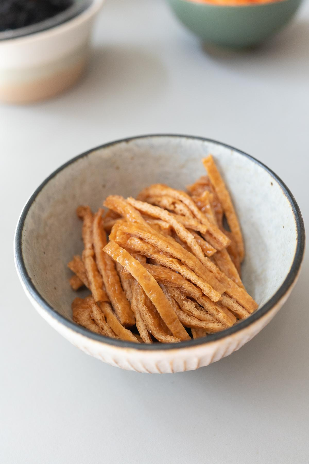 Aburaage, sliced and placed in a bowl