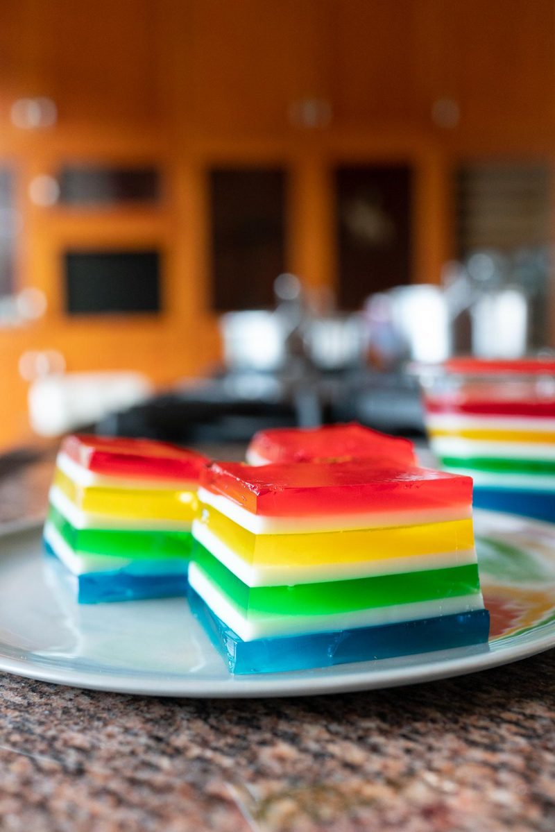 Cubes of Rainbow Jello on a plate