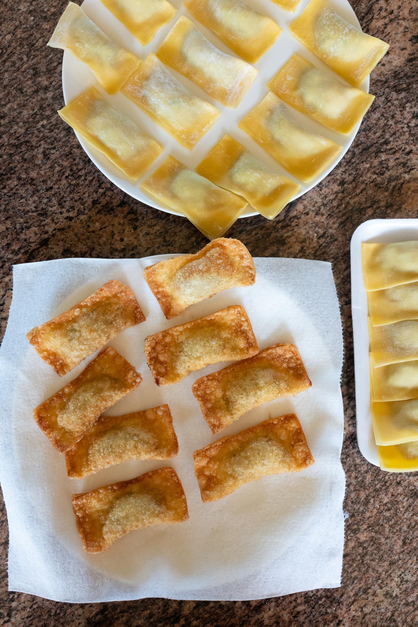 A batch of fresh fried Gau Gee on a plate. A batch of just folded Gau Gee (not yet fried) on another plate.
