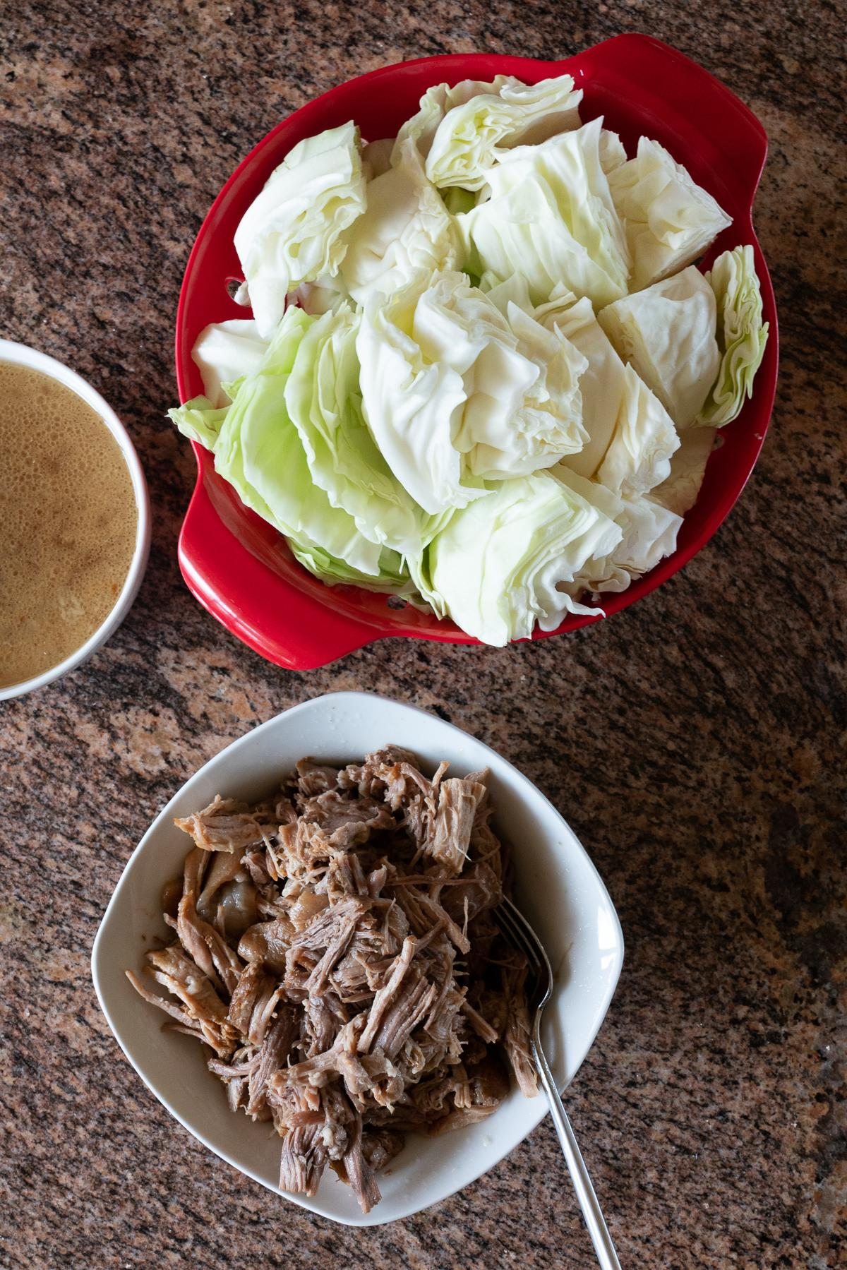 Ingredients for Kalua Pork and Cabbage: kalua pork, cabbage, and kalua pork drippings/juices (or chicken broth)