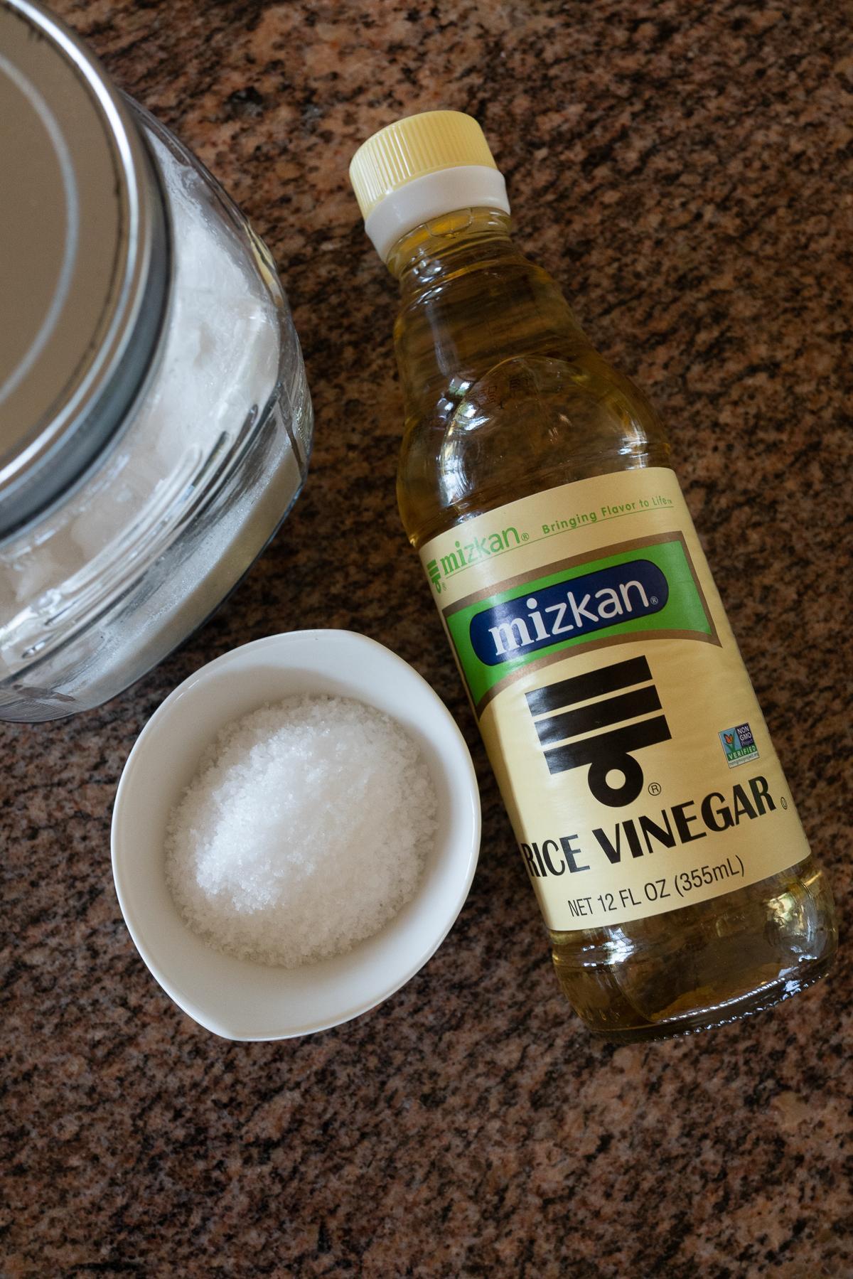Seasoning ingredients for Pickled Japanese Cucumbers: salt, sugar, and rice vinegar