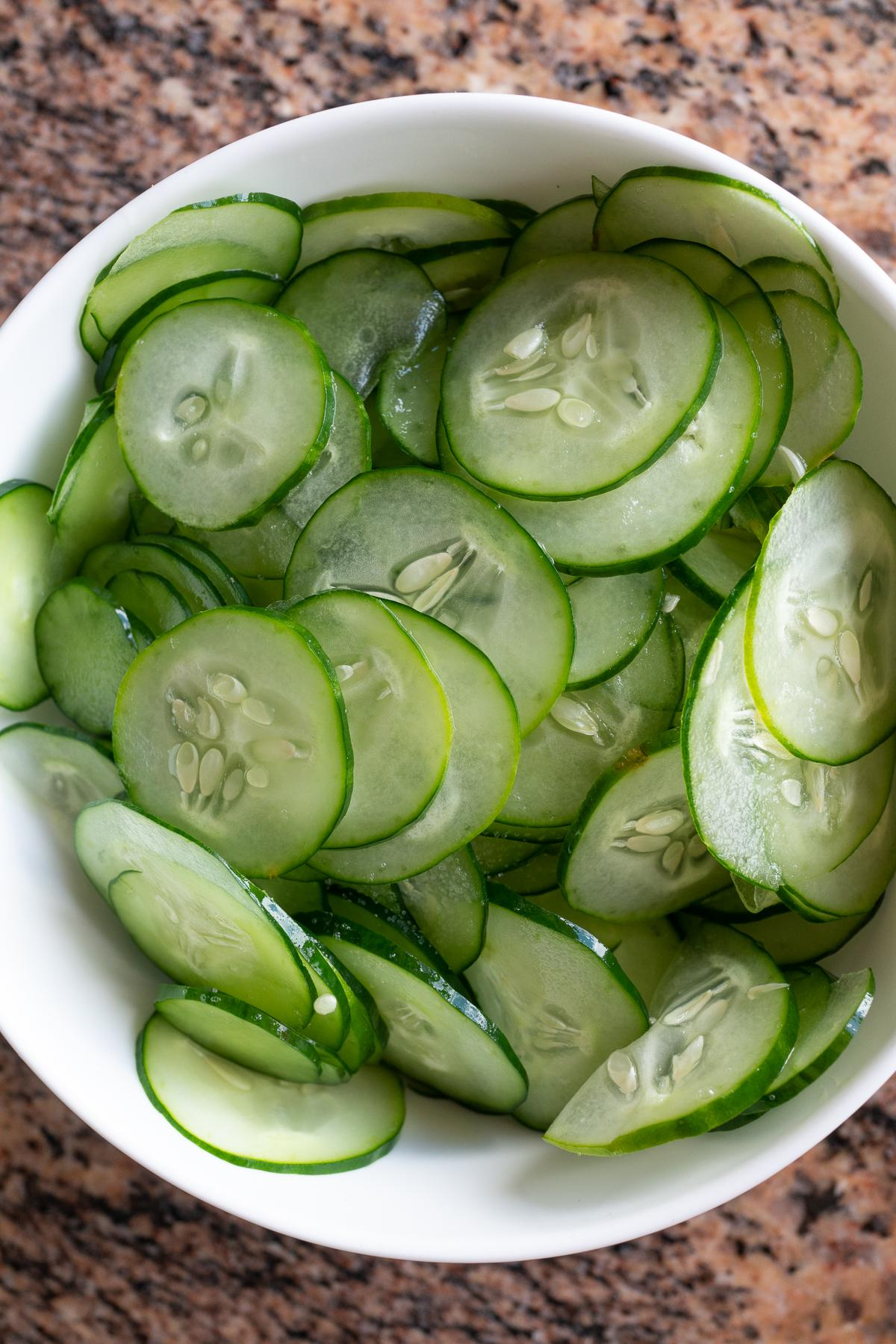 A bowl of thinly sliced Japanese cucumbers