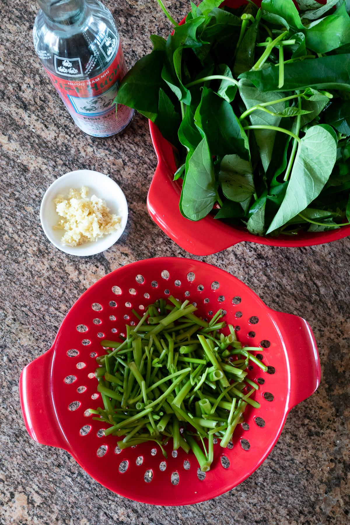 Ingredients for stir fried ong choy (ong choy, garlic, fish sauce)