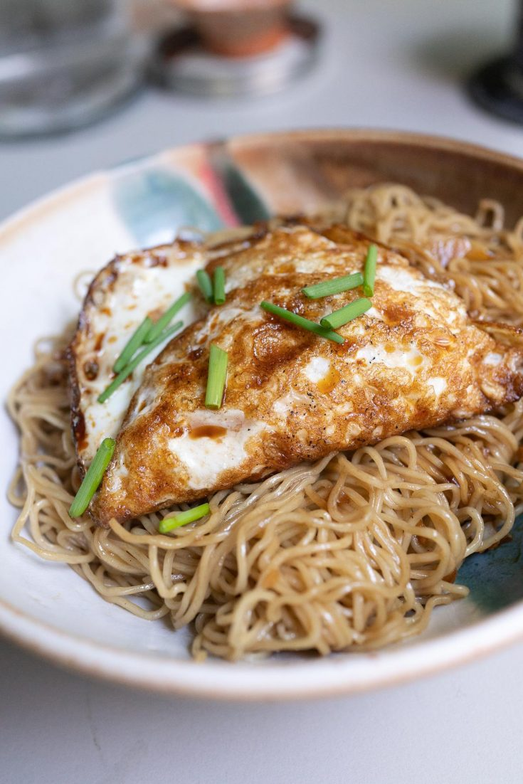 One Pocket Egg on a bed of noodles.