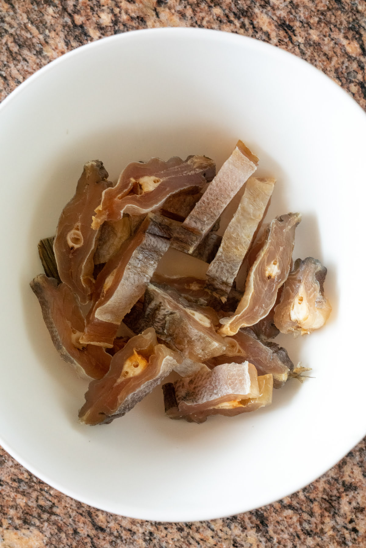 Dried salted fish cut into half-inch slices