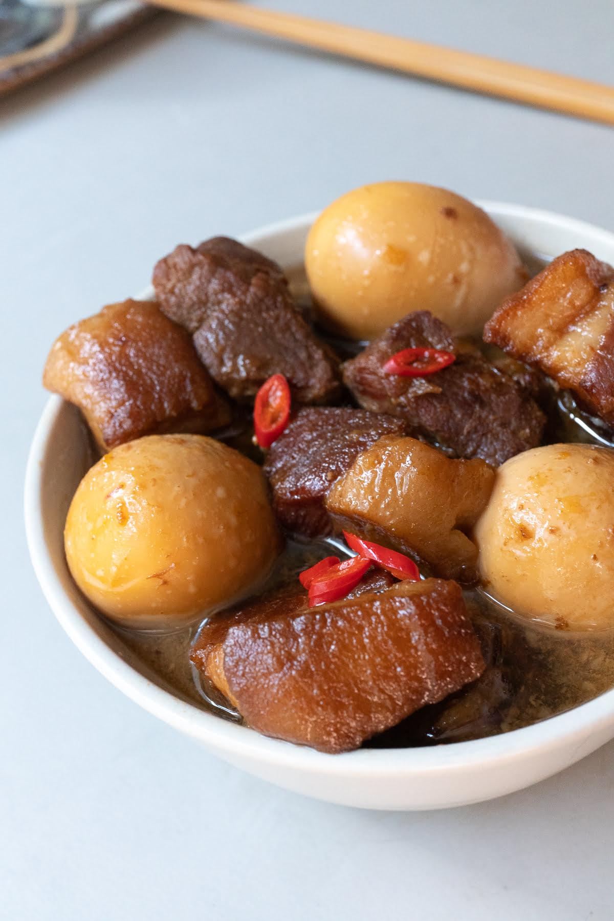 A bowl of Thit Kho (Vietnamese Braised Pork and Egg), ready to eat.