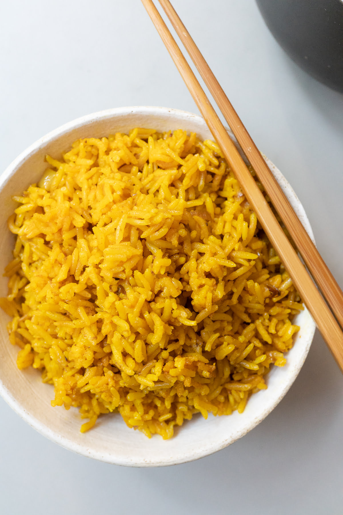 A bowl of freshly cooked turmeric rice.