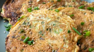 Prepared Chive Vermicelli Egg Patties served in a shallow dish.