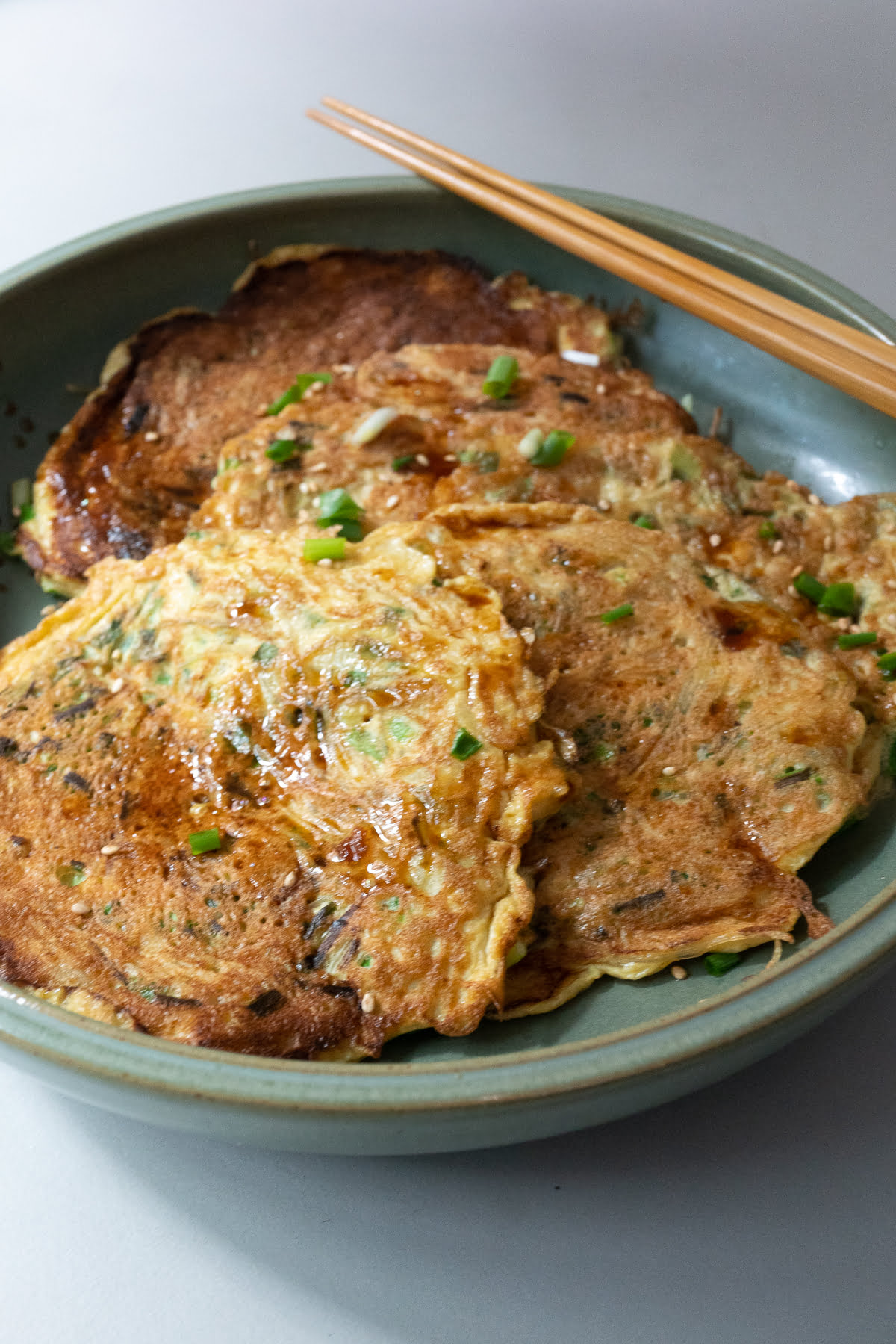 Prepared Chive Vermicelli Egg Pancakes served in a shallow dish.