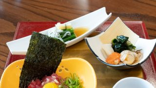 Course 1 of the Shusaizen Set from Restaurant Suntory, featuring Tuna Tartar with Heart of Palm, Avocado, and Quail Egg, Scallop and Squid Nuta, and Choy Sum Karashi-zuke.