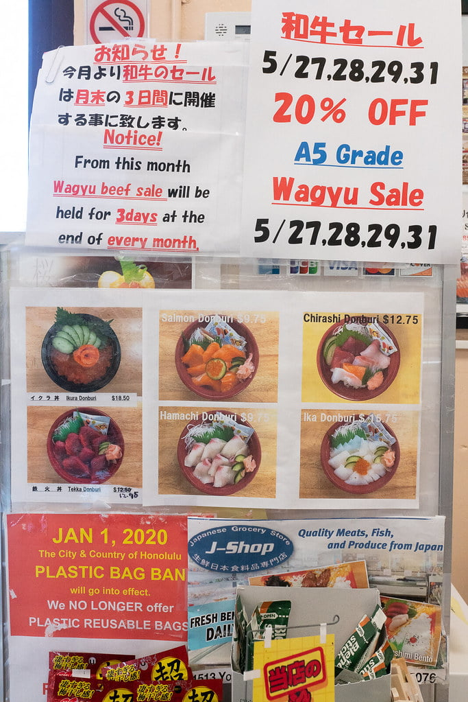 Picture menu and sale items at J-Shop in Honolulu.