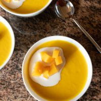 Bowls of mango pudding, ready to eat.