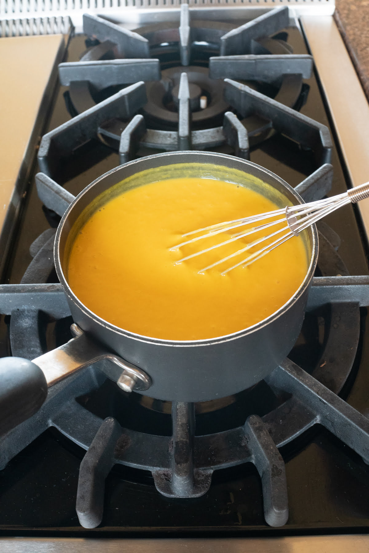 Making the mango pudding mixture on the stove.