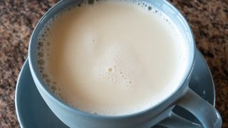 A cup of homemade soy milk, ready to drink.