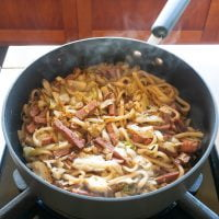 Prepared udon stir fry in a pan, ready to serve and eat!