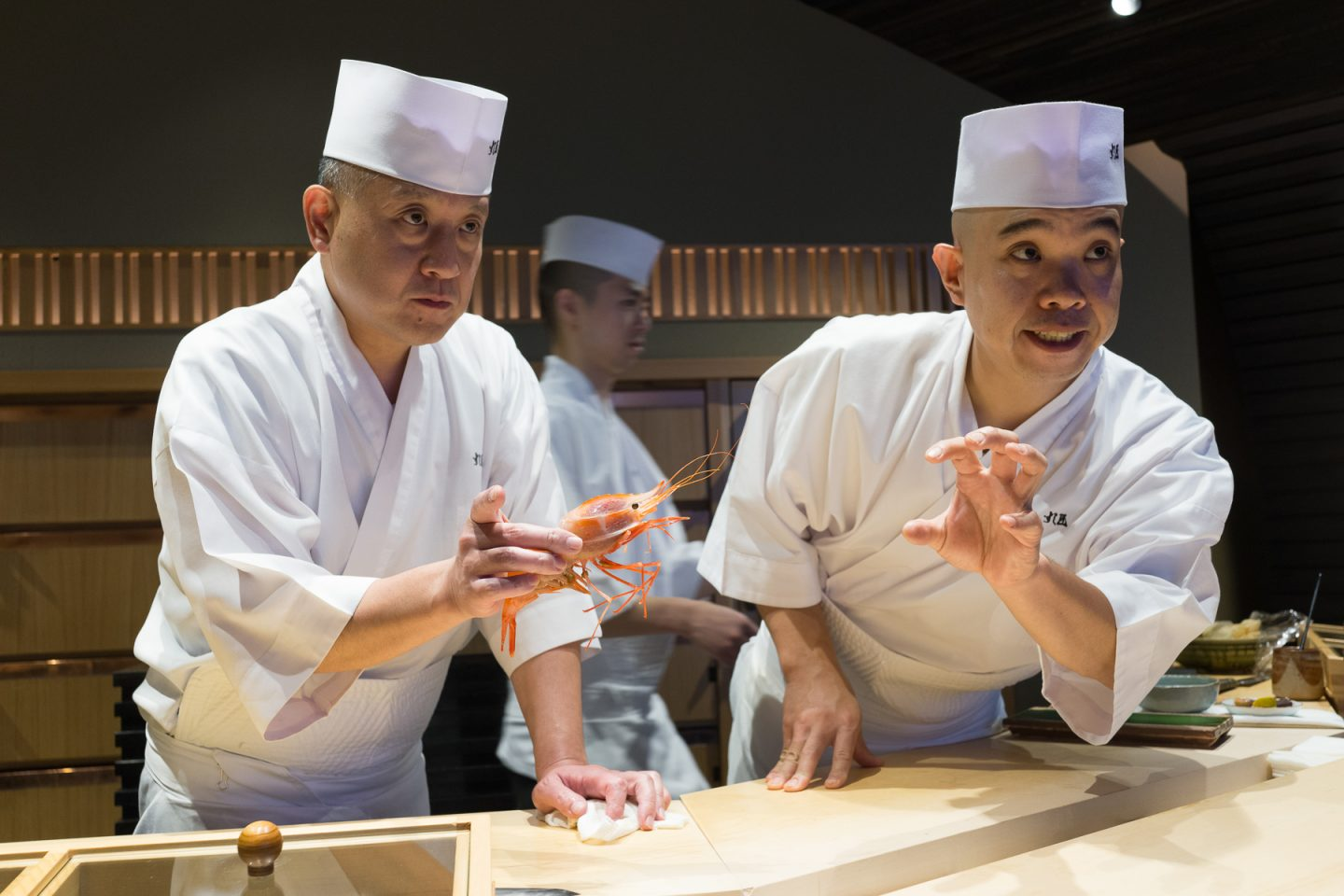 Chefs at the sushi bar of Sushi Sho.