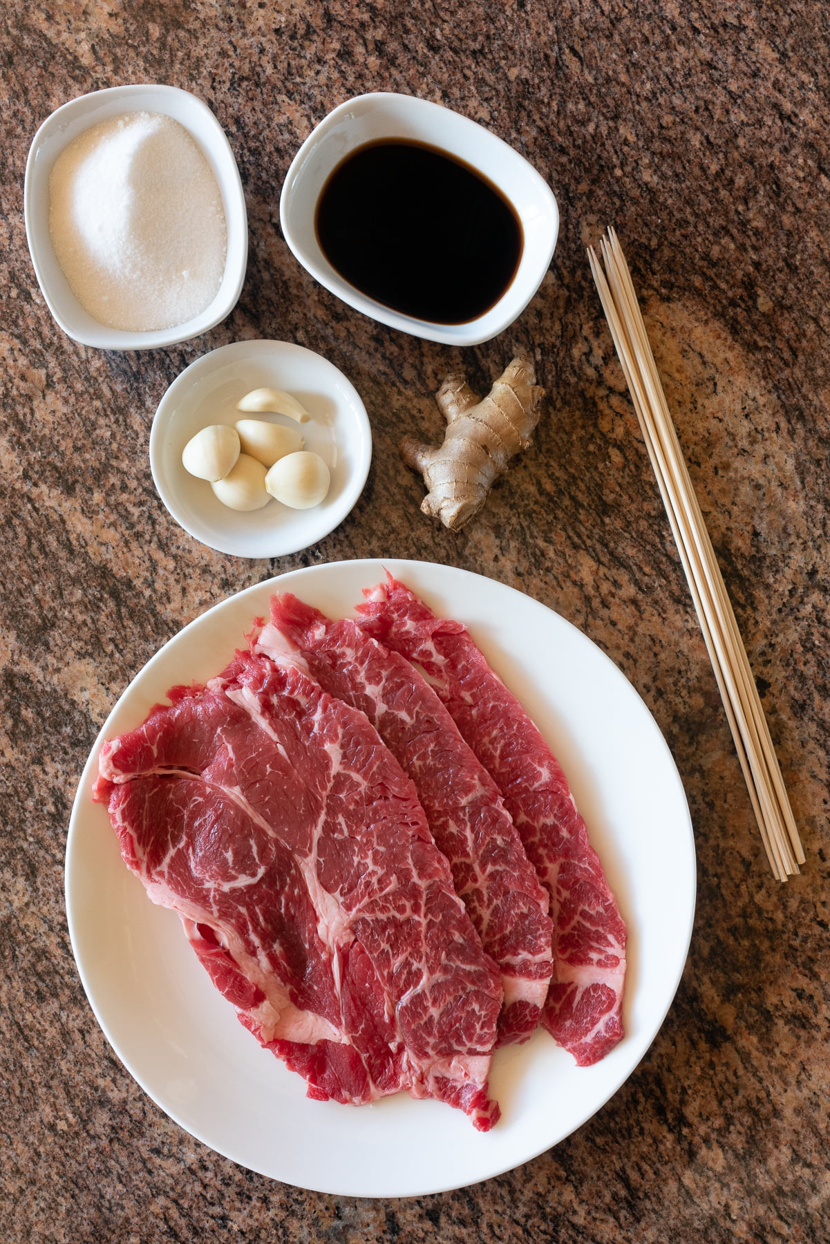 Ingredients for Beef Teriyaki Sticks laid out on a countertop.