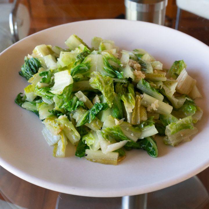 Plate of stir fried lettuce.
