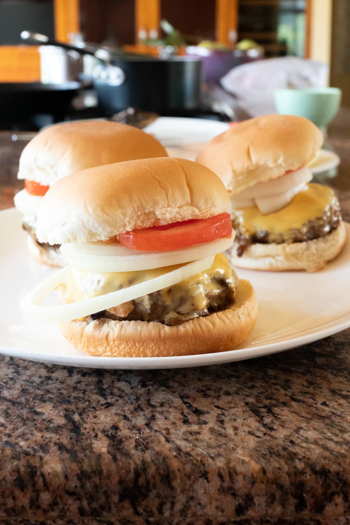 Teriyaki burgers on a plate.