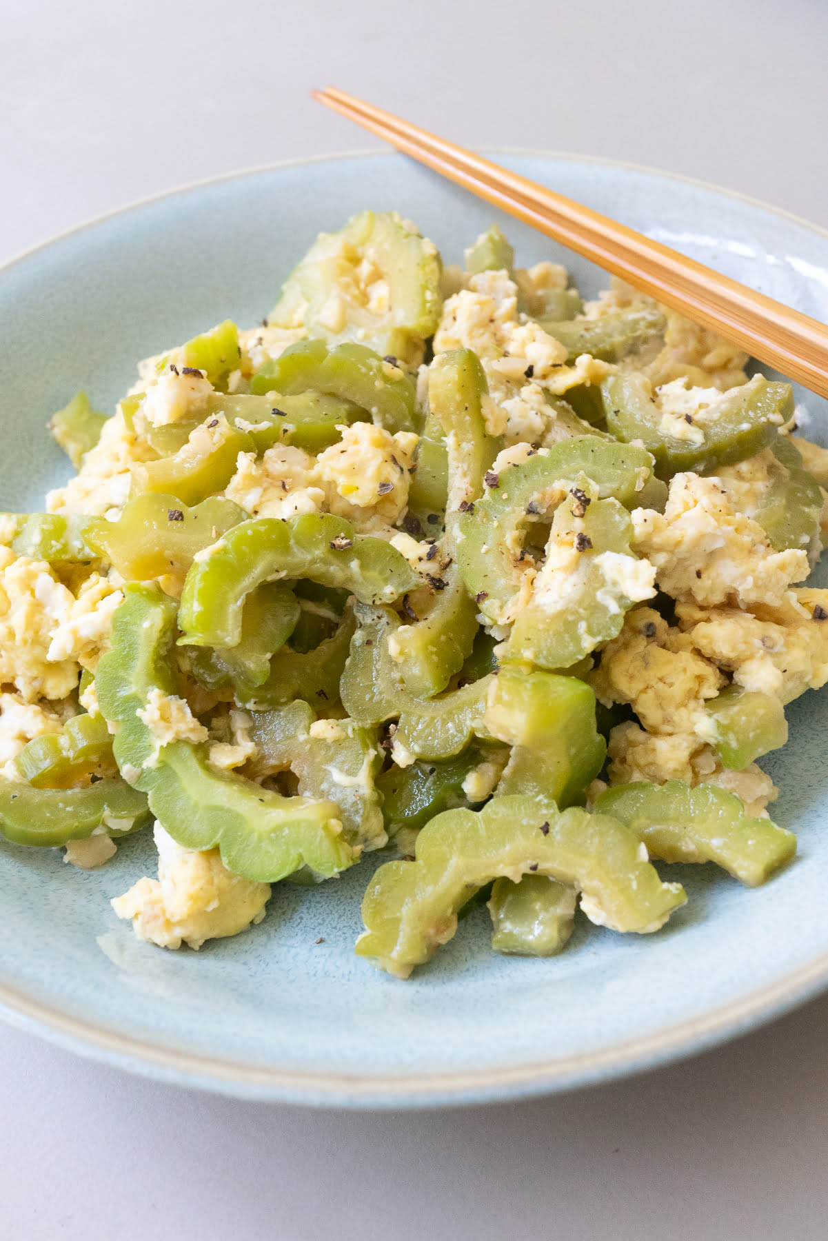 A plate of bitter melon with eggs stir fry.