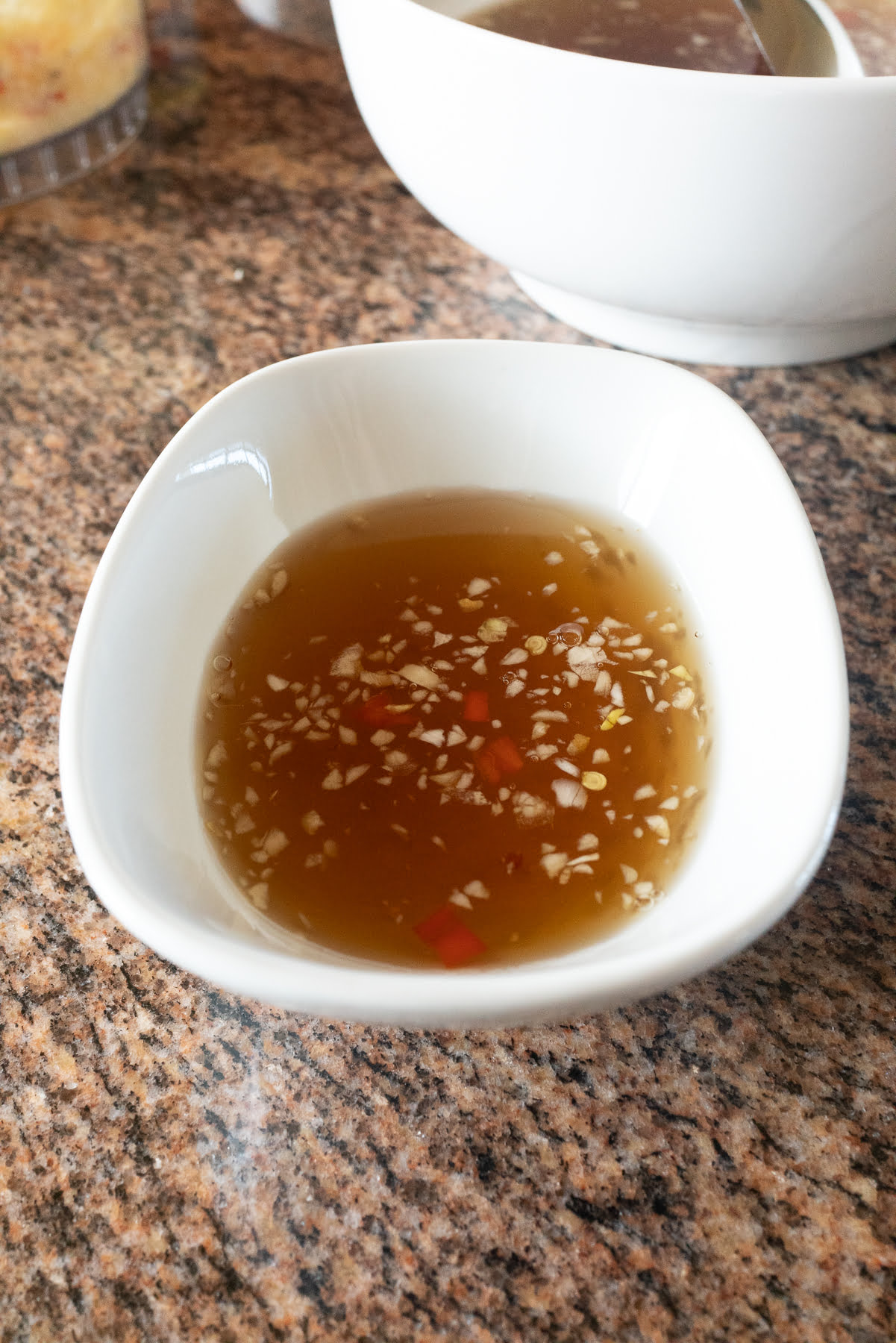 A bowl of Nuoc Cham / Nuoc Mam (Vietnamese Fish Sauce Dipping Sauce).