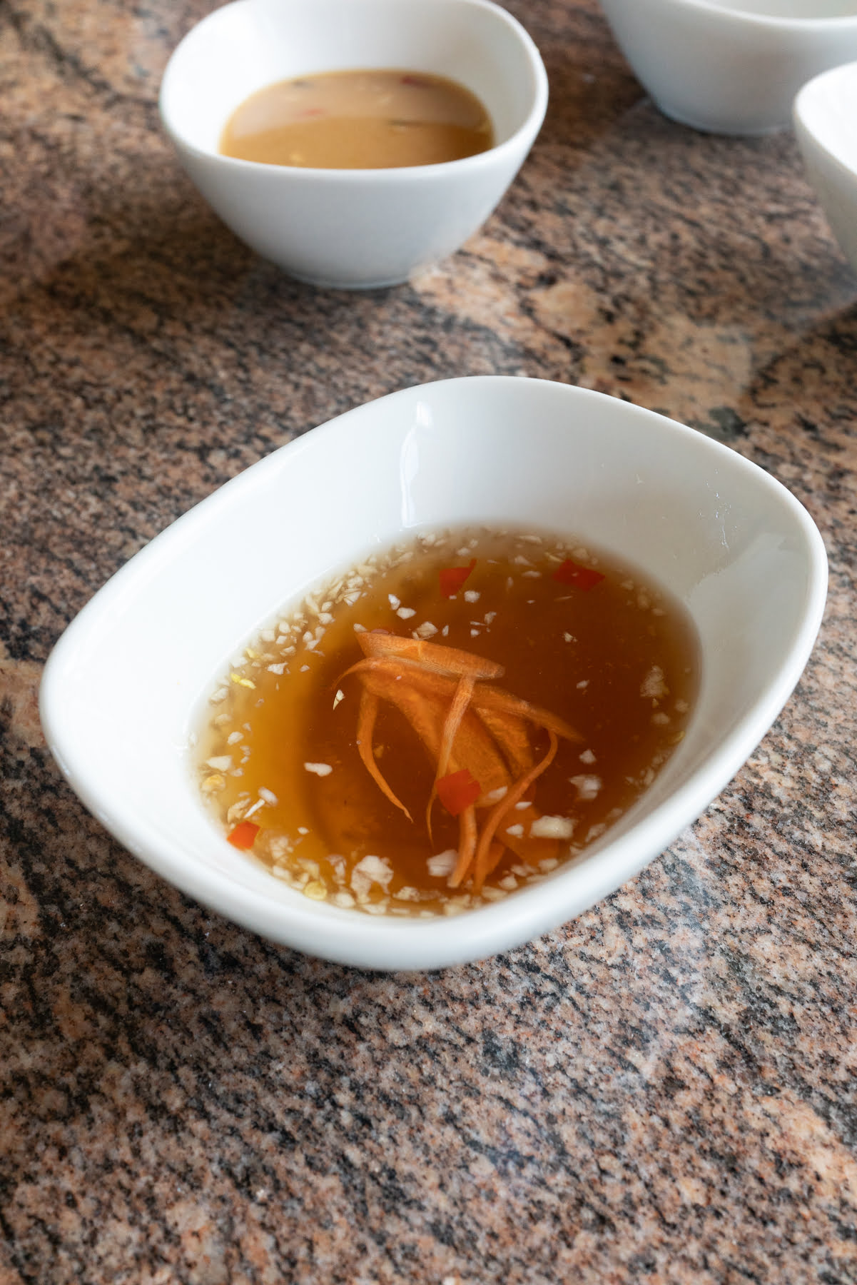 A bowl of Nuoc Mam Dipping Sauce.